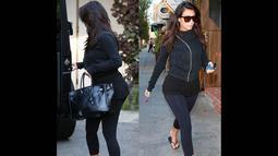 Kim Kardashian tampil santai dengan baju serba hitam dan celana legging mengunjungi sebuah klinik kecantikan, Amerika Serikat, (18/9/14). (Dailymail)