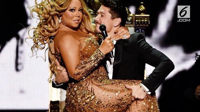 Usai operasi potong lambung, Mariah Carey tampil langsing paripurna.