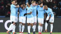 Para pemain Manchester City merayakan gol Ilkay Gundogan (3kiri) saat melawan Basel pada laga 16 besar Liga Champions di Saint Jakob-Park Stadium, Basel, (13/2/2018). Manchester City menang 4-0. (AFP/Sebastian Bozon)