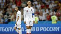 Raut sedih dan kecewa dari Cristiano Ronaldo setelah Portugal kalah dari Uruguay pada laga 16 besar Piala Dunia 2018 di Fisht Stadium, Sochi, Rusia, (30/6/2018). Portugal kalah 1-2 dari Uruguay. (AP/Francisco Seco)