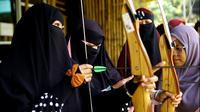 Komunitas olahraga panahan muslimah pengguna Niqab