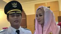 Wakil Bupati Trenggalek Mochammad Nur Arifin dan istrinya (Liputan6.com/ Dian Kurniawan)