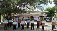 MSIG Indonesia menyerahkan donasi peralatan pencegahan penularan Covid-19 kepada 12 SD di Paliyan, Gunung Kidul, Yogyakarta. (Dok MSIG Indonesia)