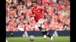 Catatan menarik pun tersaji usai Cristiano Ronaldo membobol gawang Newcastle. Ya, setelah 12 tahun dan 124 hari, ia kembali mencetak gol untuk Manchester United. (Foto: AFP/Oli Scarff)