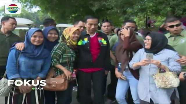 Habiskan sisa masa cuti Lebaran, Jokowi hebohkan pengunjung Kebun Raya Bogor saat tengah melakukan olahraga.