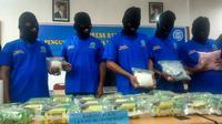 Kuri dan pengedar narkoba yang ditangkap Badan Narkotika Nasional Provinsi Riau. (Liputan6.com/M Syukur)
