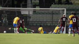 Venzuela unggul lebih dulu melalui gol yang dicetak oleh Eric Yamires pada menit ke-11. (AP/Ariana Cubillos)