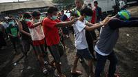 Penggerebekan narkoba di Kampung Bahari, Jakarta Utara (Liputan6.com/ Faizal Fanani)