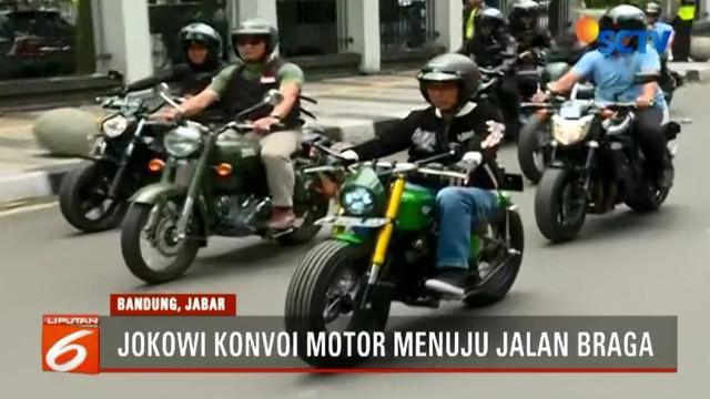 Dengan mengenakan jaket bertulisan Bubur Ayam Racer, sesampainya di kawasan Braga Capres Petahana ini disambut oleh masyarakat Bandung.