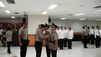 Pelantikan Kombes Pol. Erwanto Kurniadi sebagai Direktur TIndak Pidana Korupsi (Liputan6.com/Andry Haryanto)