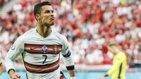 Timnas Portugal berhasil menang meyakinkan tiga gol tanpa balas atas Hungaria pada laga fase grup F Euro 2020 (Euro 2021) di Stadion Puskas Arena, Budapest, Selasa (15/6/2021). (Bernadett Szabo/Pool via AP)