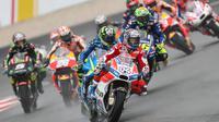 Persaingan ketat Marc Marquez dan Andrea Dovizioso membuat Max Biaggi mengklaim MotoGP 2017 menjadi musim yang kompetitif. (dok. MotoGP)