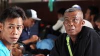 Puluhan TKI saat berada di Mapolresta Barelang setelah diamankan oleh Satreskrim Polresta Barelang di Pantai Nongsa karena pulang secara ilegal, (3/5). (CECEP MULYANA/BATAM POS/ Jawa Pos Group)