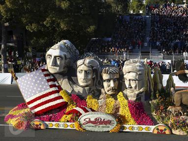 Sebuah mobil hias berbentuk wajah Presiden AS ikut berparisipasi di Rose Parade, Pasadena, California (1/1/2016). Acara Rose Parade menjadi acara yang dinantikan penduduk Pasadena setiap awal tahun (REUTERS / David McNew)