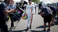 Manor Racing F1 driver Rio Haryanto walks to a drivers portrait session before the Australian Formula One Grand Prix in Melbourne. REUTERS/Jason Reed