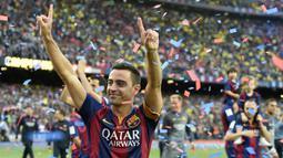 Xavi Hernandez. Gelandang elegan Barcelona ini menempati posisi ke-3 di tiga edisi, 2009-2011. Hanya ketidakberuntungan saja yang membuatnya gagal, yakni berada satu tim dengan Lionel Messi. (AFP/Lluis Gene)