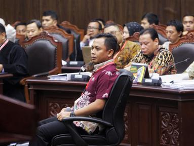 Saksi Tim Hukum Jokowi, Candra Irawan saat menjadi saksi dalam sidang lanjutan sengketa Pilpres 2019 di Gedung MK, Jakarta, Jumat (21/6/2019). Dalam sidang ini Tim hukum Jokowi menghadirkan empat orang saksi, Candra Irawan menjadi saksi yang pertama dalam persidangan. (Liputan6.com/Johan Tallo)