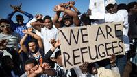 Pengungsi Afrika di Israel menggelar aksi demo. (Getty Images)