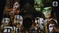 Pemutaran video mapping di Gereja Katedral menampilkan tokoh-tokoh pemuda yang terlibat dalam Kongres Pemuda II , Jakarta, Minggu (27/12/2019). Pemutaran video mapping ini untuk memperingati Hari Sumpah Pemuda ke-91 dan berlangsung hingga 28 Oktober. (Liputan6.com/Helmi Fithriansyah)