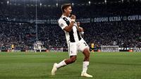 Pemain Juventus, Paulo Dybala melakukan selebrasi usai mencetak gol ke gawang Young Boys dalam Grup H Liga Champions di Stadion Allianz, Turin, Italia, Selasa (2/10). Juventus membungkam Young Boys 3-0 lewat hattrick Dybala. (Marco BERTORELLO/AFP)