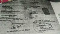 Dokumen WNA Singapura, M, yang melakukan kekerasan terhadap dua anak perempuannya yang masih SD di Majenang, Cilacap. (Liputan6.com/Muhamad Ridlo)