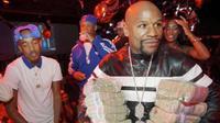 Money Man membuat heboh dengan membawa dua tumpukan uang tunai saat berpesta di sebuah klub malam di Amerika Serikat.