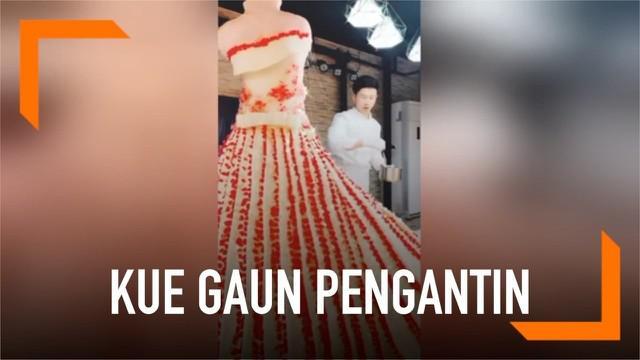 Seorang pembuat roti menciptakan kue menakjubkan di China. Ia mengubah sebuah kue besar dan cantik menyerupai gaun pengantin.