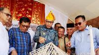 Masjid Jami' Nurul Hasanah dibangun berdasarkan konsep tradisional Rumoh Aceh yang dipadukan dengan konsep tradisional khas Sulawesi Tengah Tambo dan Lobo. (Liputan6.com/ Rino Abonita)