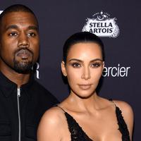Kim Kardashian dan Kanye West (Dimitrios Kambouris / AFP)