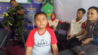 Rangga, bocah yang dititipkan orangtuanya saat mudik ke Ponorogo. (Liputan6.com/Dian Kurniawan)