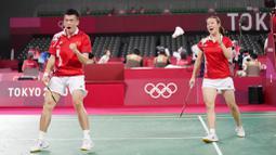Pasangan Indonesia ini harus mengakui ketangguhan unggulan pertama asal China, Zheng Siwei/Huang Yaqiong. Wakil Indonesia itu kalah dua gim langsung dengan skor 21-17 21-15. (Foto: AP/Dita Alangkara)