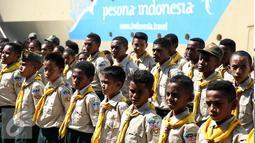 Puluhan peserta Jambore asal Papua tiba di Pelabuhan Tanjung Priok, Jakarta, Kamis (30/6). Mereka akan mengikuti jambore se-asia pasifik pada tanggal 12-16 Juli diikuti 14 Negara asia pasifik yang diselenggarakan di Bandung. (Liputan6.com/Faizal Fanani)