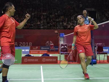 Hary Susanto/Ratri Oktlia Leani gpebulutangkis Indonesia meraih medali emas di nomor tganda campuran SL3-SU5 setelah mengalahkan Thailand pada Asian Para Games 2018 di Istora Senayan, Sabtu (13/10/2018).  (Bola.com/Peksi Cahyo)