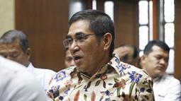 Mantan Hakim MK Hamdan Zoelva memberi keterangan pada sidang peninjauan kembali (PK) di Pengadilan Tipikor, Jakarta, Rabu (31/10). Sidang beragendakan mendengarkan keterangan saksi ahli yang dihadirkan pemohon. (Liputan6.com/Herman Zakharia)