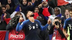 Striker Prancis, Oliver Giroud berselebrasi usai mencetak gol ke gawang Turki pada pertandingan Grup H Kualifikasi Piala Eropa 2020 di Stade de France di Saint Denis, utara Paris (14/10/2019). Dengan Hasil ini kedua tim memilki poin sama 19. (AP Photo/Thibault Camus)