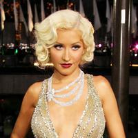 Christina Aguilera menjadi cover majalah Paper. Namun uniknya, ia tampil dengan gaya yang tak biasanya. (GRAMMY.com)
