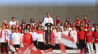 Menteri Koordinator Bidang Pembangunan Manusia dan Kebudayaan (Menko PMK) Puan Maharani mendampingi Presiden Joko Widodo dalam acara Harmoni Indonesia 2018, di Plaza Timur Gelora Bung Karno, Minggu (5/8).