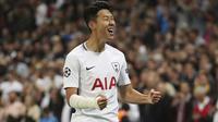 Pemain Tottenham Hotspur, Son Heung-Min merayakan golnya ke gawang Dortmund pada laga grup H Liga Champions di Wembley stadium,  London, (13/9/2017). Tottenham menang 3-1. (Nick Potts/PA via AP)