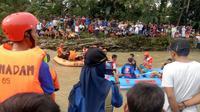 Bocah 8 Tahun Hilang Terseret Arus saat Selamatkan Sang Adik. (Liputan6.com/Ahmad Sudarno)