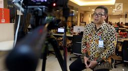 Direktur Utama PT Railink Heru Kuswanto saat wawancara di kantor Kapan Lagi Youniverse di Jakarta, Kamis (15/11). Kunjungan tersebut untuk bersilaturahmi dan melakukan wawancara seputar kereta bandara. (Liputan6.com/Johan Tallo)