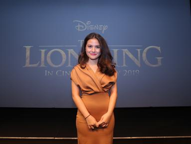 Marsha Aruan tampil begitu elegan saat hadiri gala premier Lion King. Seperti diketahui, Lion King tayang serentak hari ini, 17 Juli 2019. Dengan memakai busana berwarna oranye, pacar El, Anak Ahmad Dhani, terlihat begitu menawan (KapanLagi.com/Daniel Kampua)