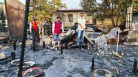Kebakaran rumah di Kabupaten Indragiri Hilir yang menewaskan satu keluarga. (Liputan6.com/M Syukur)