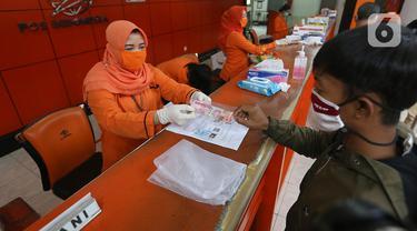 Kantor Pos Bogor Salurkan Bantuan Sosial Tunai ke Warga Terdampak Covid-19