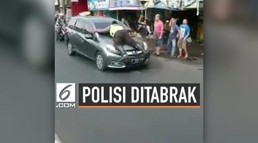 Seorang polisi ditabrak sengaja oleh pengendara mobil saat polisi mencoba menghentikan mobil dengan paksa.