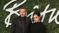 David dan Victoria Beckham di karpet merah British Fashion Awards 2014, London, Inggris. (JUSTIN TALLIS / AFP)