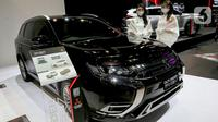 Distributor resmi MMKSI memperkenalkan produk dan layanan Mitsubishi Motors di Indonesia pada mobil seperti New Pajero Sport, Xpander dan Xpander Cross, Eclipse Cross, dan Outlander PHEV pada IIMS hybrid 2021. (Liputan6.com/Pool/Mitsubishi)