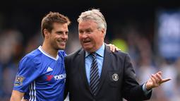 1. Guus Hiddink - Tahun 2009 Hiddink ditunjuk sebagai pelatih sementara Chelsea untuk kali pertama. Pelatih berkebangsaan Belanda tersebut menggantikan Jose Mourinho yang tak lagi mampu mempertahankan performa apik Chelsea. (AFP/Glyn Kirk)