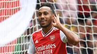 Striker Arsenal Pierre-Emerick Aubameyang merayakan gol ke gawang Olympique Lyon pada laga Emirates Cup 2019, Minggu (28/7/2019). (Twitter Arsenal)