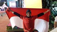 Atlet panjat tebing Indonesia, Aries Susanti Rahayu, meraih medali emas pada nomor speed atau kecepatan Asian Games 2018, Kamis (23/8/2018). (Bola/Riskha Prasetya)