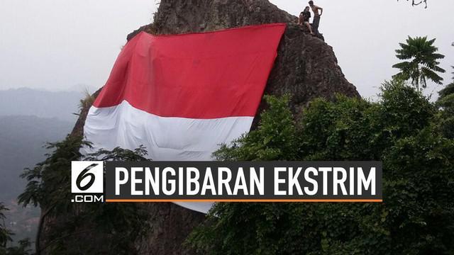 Menjelang HUT kemerdekaan RI ke-74, bendera Merah Putih terlihat dimana-mana. Termasuk sengaja dikibarkan di tempat-tempat ekstrim di Indonesia.